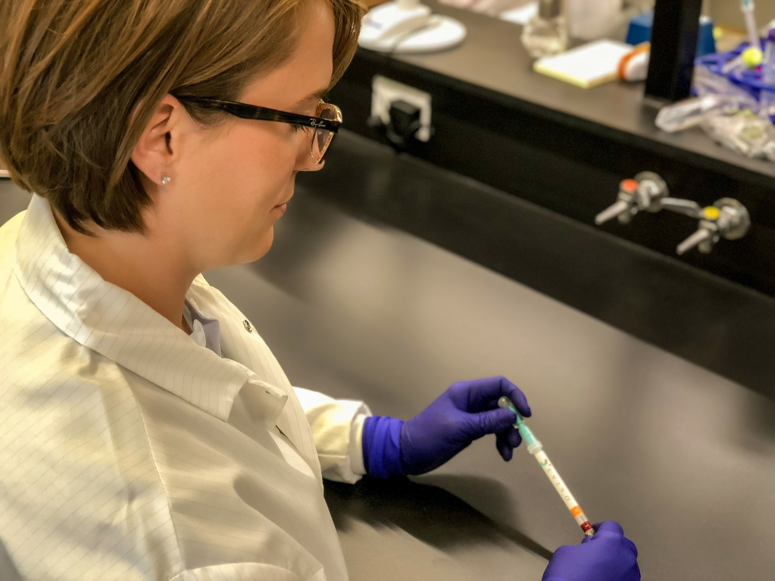 Dr. Bethany Henrick, Ph.D., Director of Immunology and Diagnostics for Evivo, holds prototype for first-ever point-of-care infant gut microbiome screening test