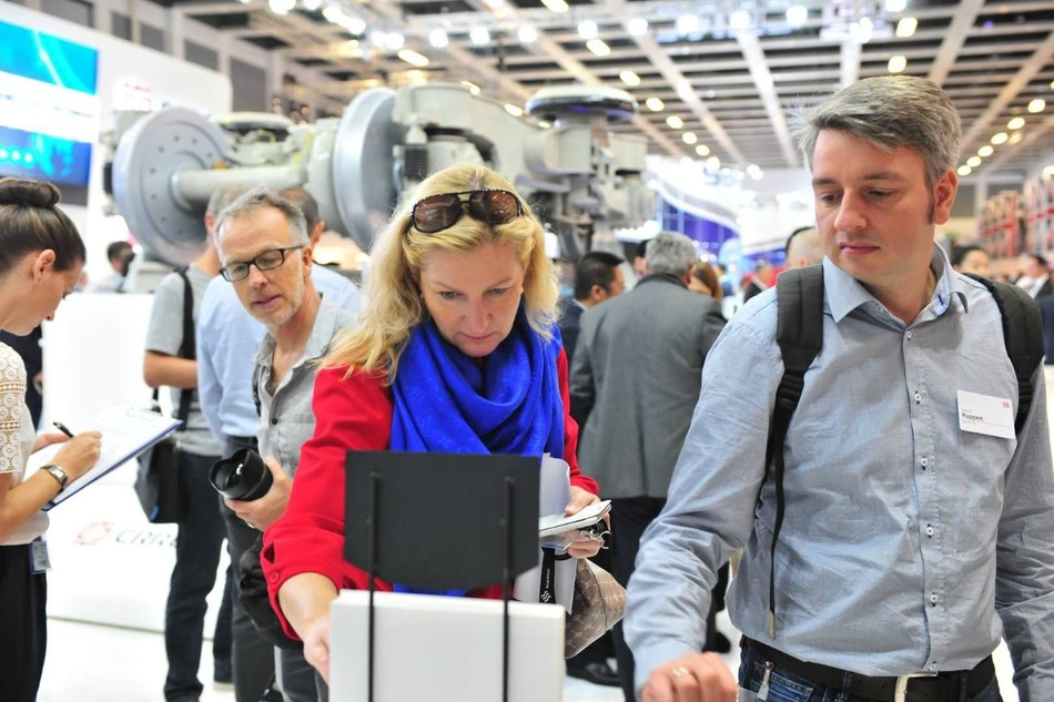 Two visitors show high interest for CRRC's latest and most advanced product offerings exhibited on the stand at InnoTrans 2018