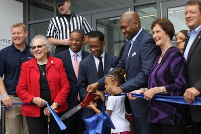 Co-founders Kendrick Ashton and Craig Dixon cut the ribbon on The St. James's flagship complex in Springfield, Virginia, with assistance from local leaders and family members.