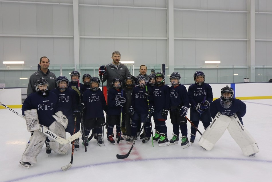 Washington Capitals star and founding member of The St. James Alex Ovechkin joins the U10 travel team ahead of their exhibition game during The St. James grand opening.