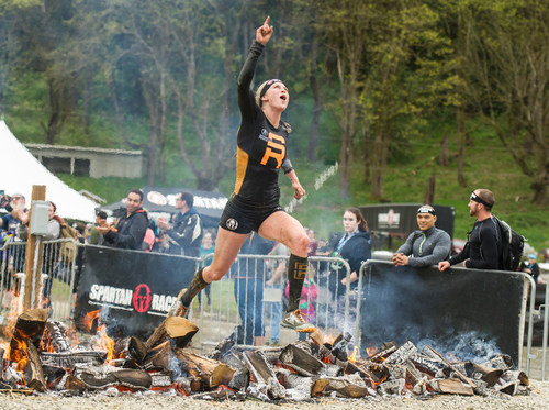 """Spartan Pro Alyssa Hawley completes the Fire Jump before crossing the finish line during the Spartan U.S. National series. The first episode of """"Spartan: The Championship Series"""" airs Sunday, September 23 at 3pm ET on ESPN2."""