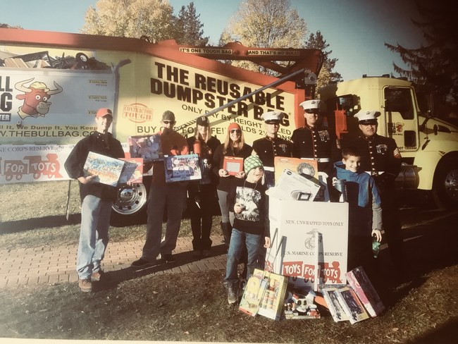 BullBag volunteers annually to assist all Veterans with their causes - this photo is the annual photo with the US Marines Toys for Tots