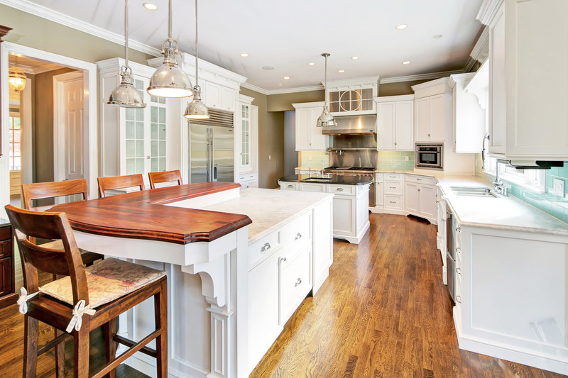 A light and bright kitchen includes top-quality appliances and dual islands for food preparation and service. More at NewJerseyLuxuryAuction.com.