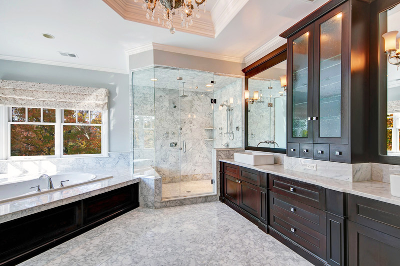 The master bath contrasts dark wood with light marble finishes, and offers a large soaking tub and oversized shower with two, multi-jet stations. More features at NewJerseyLuxuryAuction.com.