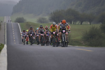 Team Aliexpress are leading the bicycling race on the road in the grassland of the Fairy Mountain with a elevation of 2,000 meters.