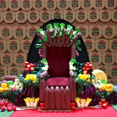 Visitors to The Pizza Experience in L.A. can sit on a throne made of toppings while enjoying a slice of Round Table Pizza