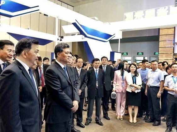 Ma Xingrui, Deputy Secretary of Guangdong Provincial Committee and Governor of Guangdong Province, Shen Haixiong, Vice Minister of the Publicity Department of the Communist Party of China and President of the China Media Group, and Guo Yonghang, Secretary of Zhuhai Municipal Committee visit Ping An's booth.