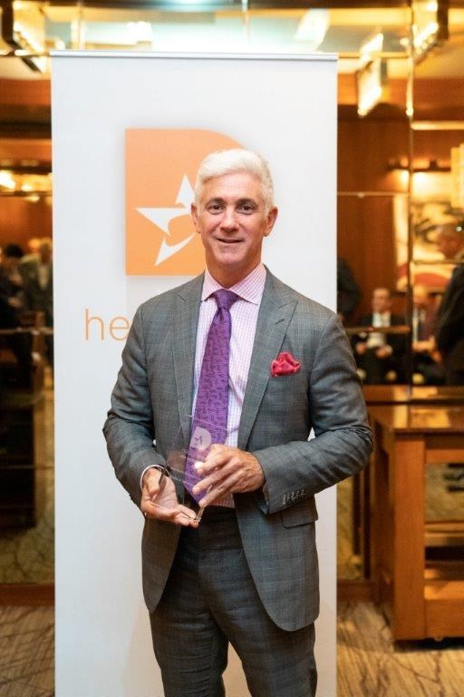 Ron Geffner accepts award at Hedgeweek award ceremony.