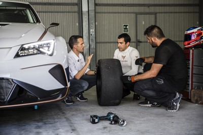 CUPRA team members next to the new e-Racer, the first fully electric touring race car (PRNewsfoto/CUPRA)