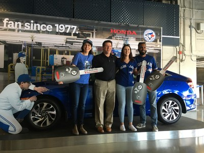 Honda Canada's Executive Vice President and Chief Operating officer, Barry Holt, presented three lucky baseball fans with the keys to a brand new Honda Civic Sedan as part of Honda's Fan Appreciation Weekend. In addition, Honda Canada made a substantial $100,000 donation to Jays Canada Foundation. (CNW Group/Honda Canada Inc.)