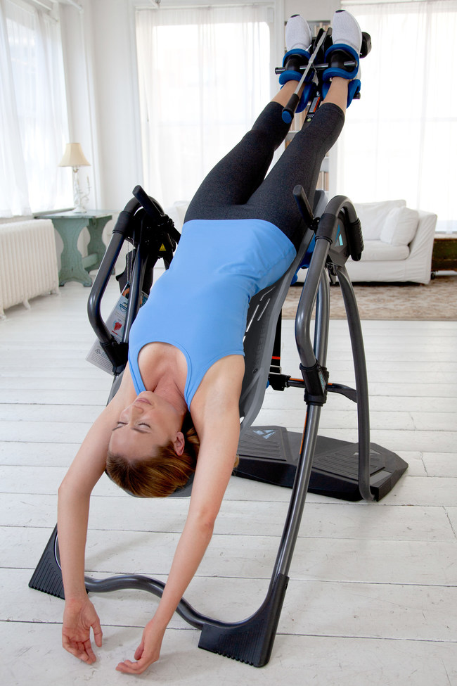 Reduce back pain, relieve stress and tension, and increase flexibility and blood flow with the Teeter FitSpine Inversion Table.