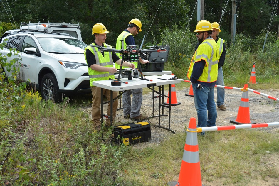 Pilots prepare for drone liftoff to obtain an aerial view of the PSEG Long Island electric transmission and distribution system.
