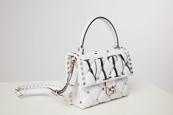 White studded Valentino bag from Mariel Haenn and Rob Zangardi's eBay Stylist Sale collection. Proceeds benefit Create Now.