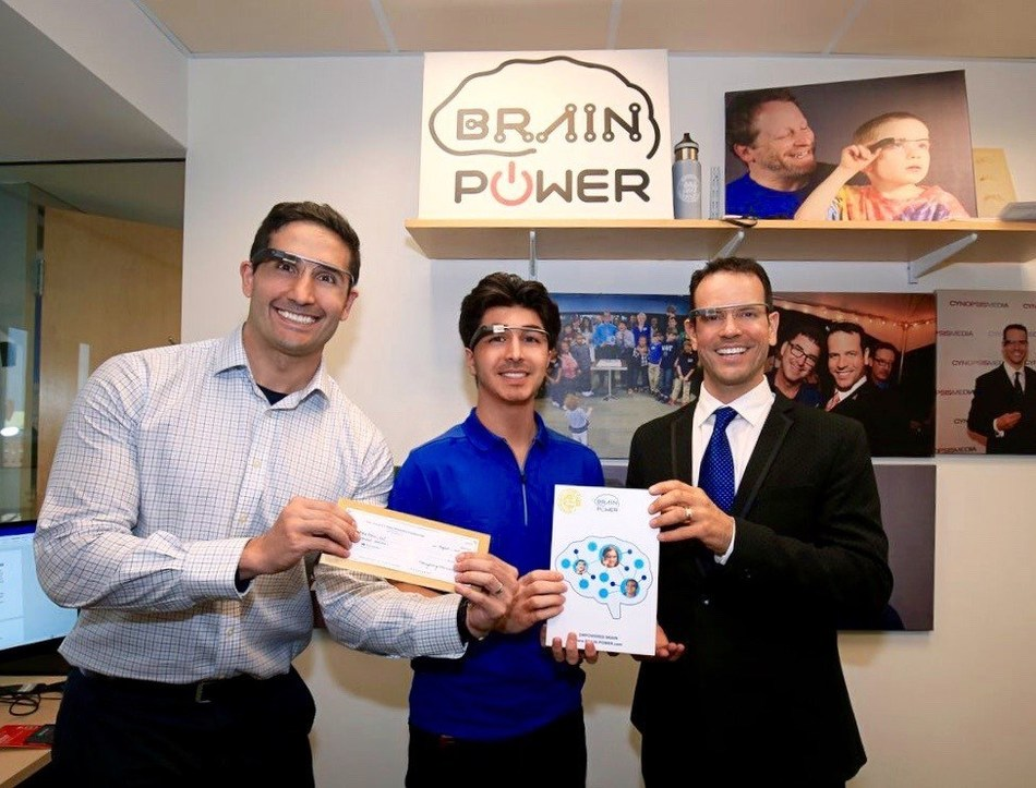 Jamie Menhall, (center) the teen-founder of GoFAR, is pictured along with Brain Power's founder and CEO, Dr. Ned T. Sahin (right), and Brain Power's Chief Medical Officer Dr. Arshya Vahabzadeh (left) All three are wearing the Empowered Brain™.