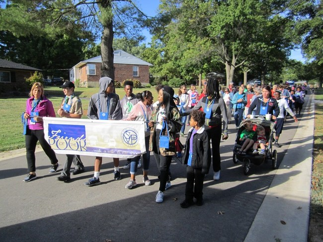 Members of the St. Clement of Rome and St. Elizabeth Mother of John the Baptist Conferences in St. Louis walk with people from the community at the 2017 Friends of the Poor Walk/Run. Funds raised help provide utility, rent and food assistance to people in need. (Photo: Society of St. Vincent de Paul)