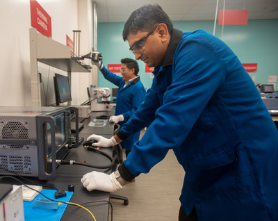 The new DuPont Silicon Valley Technology Center is home to four labs to enable real-time collaboration, prototyping, testing and iterative design. In the characterization lab, Dr. Rapolu is setting up equipment to measure signal loss in materials that can enable 5G technology.