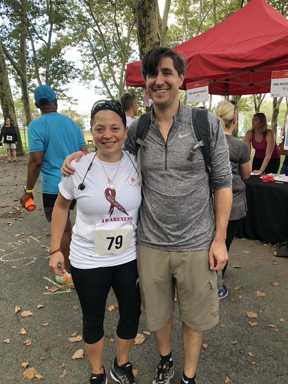 Montefiore patient, Heather Grzanka, with Dr. David J. Altschul, her Montefiore neurosurgeon, after completing a 5k run to support the Brain Aneurysm Foundation in September 2018. (PRNewsfoto/Montefiore Health System)