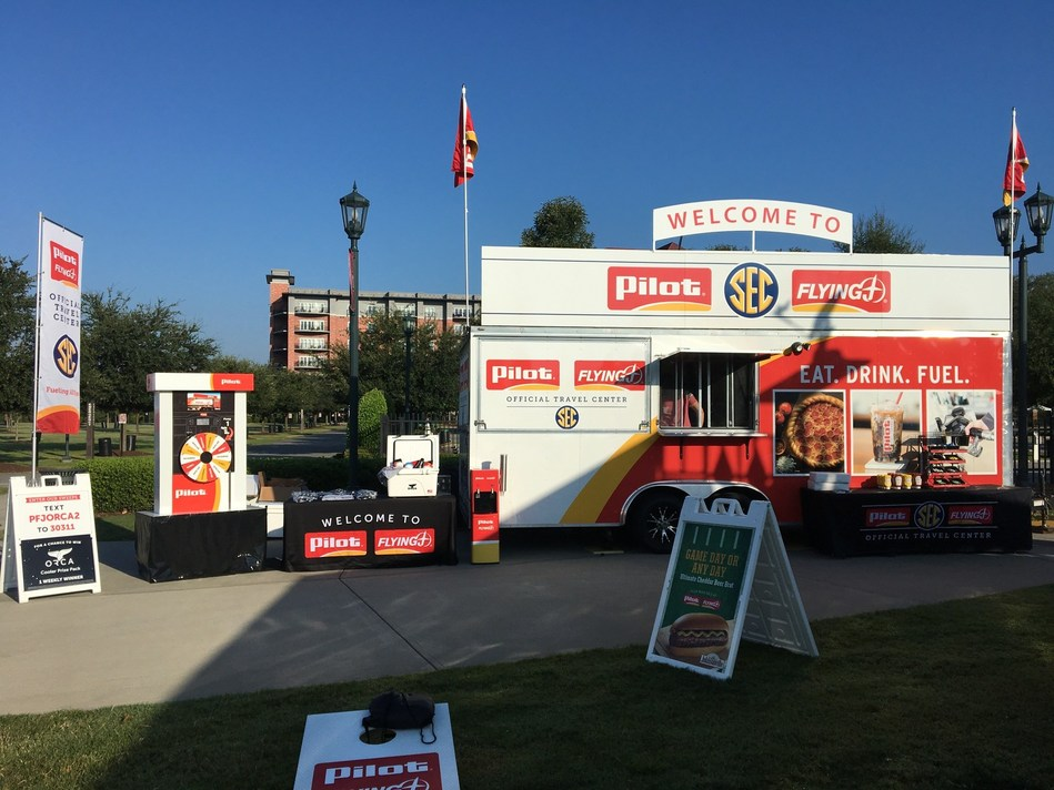 """As part of the brand's status as """"Official Travel Center of the SEC,"""" Pilot Flying J will be bringing its mobile """"Fueling All Fans Experience"""" unit to various college campuses alongside SEC Nation, which will offer two of Pilot Flying J's in-store hospitalities right outside the stadium: cold brew coffee and Johnsonville Cheddar Beer Brats. Fans can also enter on-site to win the weekly """"ultimate tailgate package"""" giveaway from ORCA and Pilot Flying J."""