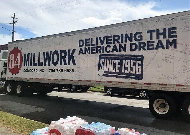 A tractor trailer donated by 84 Lumber drops off various necessities in New Bern, N.C.