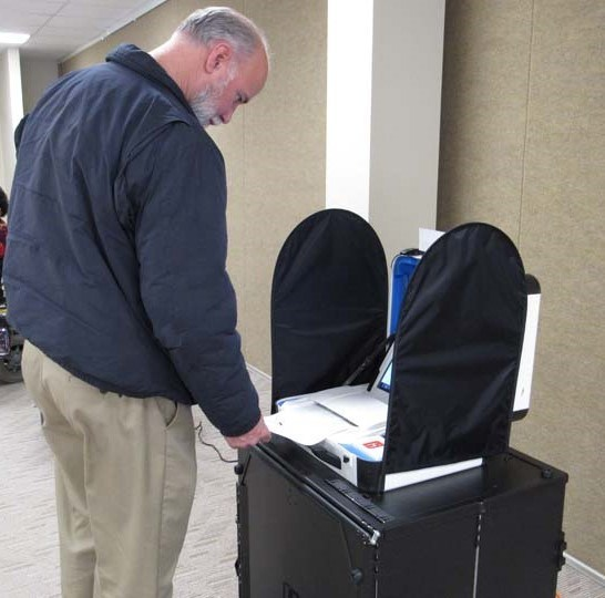 The mock election put every aspect of Verity to the test. Here a voter scans his completed ballot.