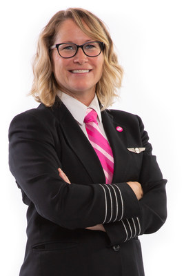 Carey Steacy, WestJet Captain and Breast Cancer Awareness Month Ambassador wearing custom-designed pink neckwear and pink 'personality' pin (CNW Group/WESTJET, an Alberta Partnership)