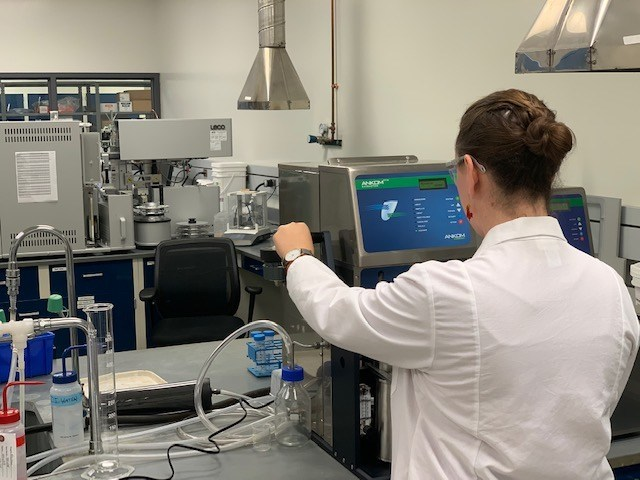 An automated crude fat determination is just about to finish and Maxxam's analyst is removing the samples to dry them. (CNW Group/Maxxam)