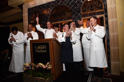 Featured chefs at Robb Report's Culinary Masters gather at The Gala Dinner podium at Addison Restaurant, where the evening saw $200k in proceeds generated for the ment'or BKB Foundation.