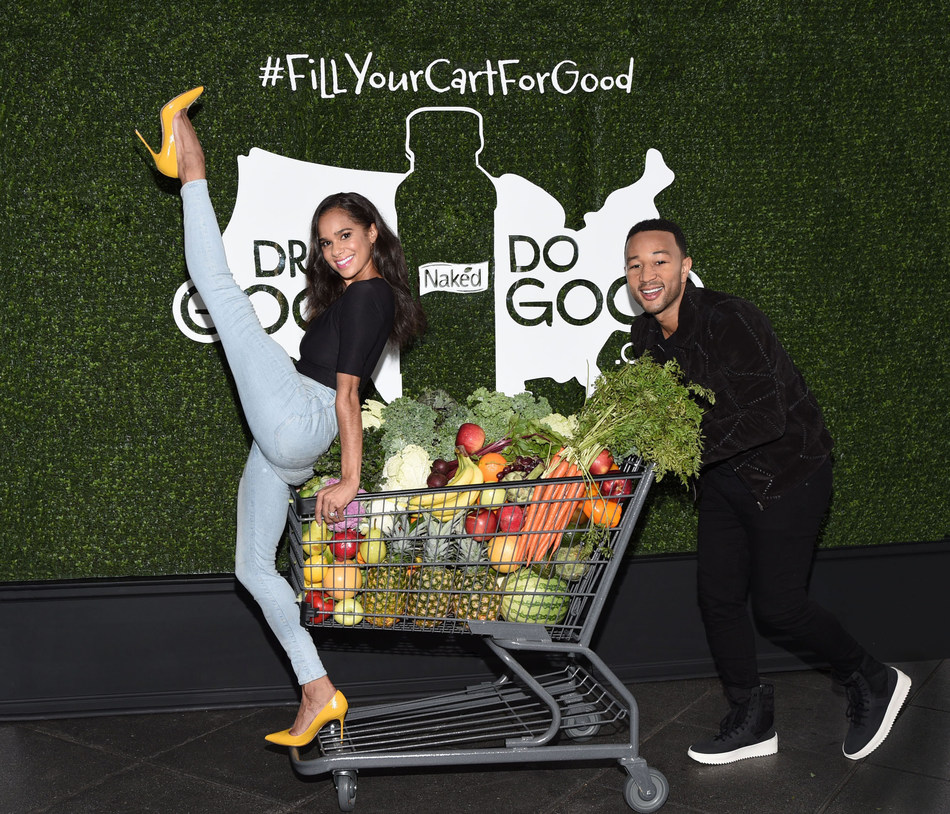 At the launch of Naked's Drink Good Do Good campaign, John Legend and Misty Copeland show off their Shopping Cart dance helping communities in need. (PRNewsfoto/Naked)