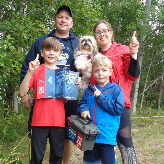 The Wood Family find box 28 along the Jitney Trail in Pictou, Nova Scotia (CNW Group/Royal Canadian Geographical Society)