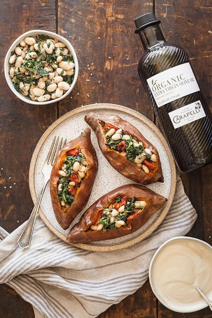 Vegan Stuffed Sweet Potatoes with Spinach, White Beans and Carapelli Organic Extra Virgin Olive Oil
