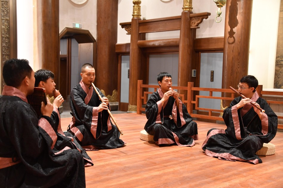Players are playing Chinese traditional musical instrument during the Fifth Nishan Forum on World Civilizations.