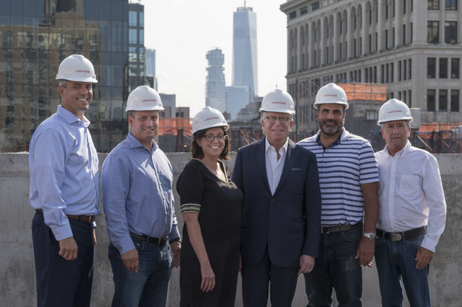 (Left to right) Lightstone's Greg Iannacone, Mark Green, Meghan Bobertz, President Mitchell Hochberg, Chris Baxter and Bill Hickman, celebrate the topping out of Moxy East Village.