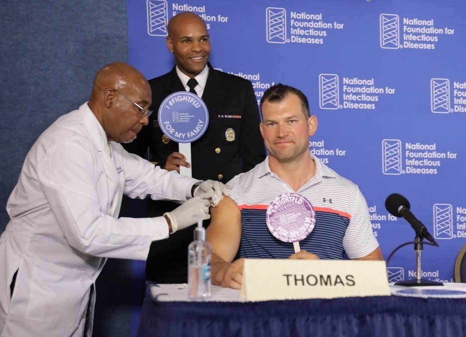 Joe Thomas, former Cleveland Browns NFL player & 2006 Outland Trophy Winner, leads by example by getting vaccinated against influenza at the 2018 National Foundation for Infectious Diseases (NFID) Influenza/Pneumococcal News Conference. The Centers for Disease Control & Prevention (CDC) recommends that everyone age 6 months and older get vaccinated against influenza each year. Thomas is NFID Flu Ambassador.