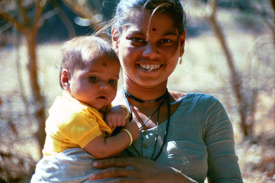 A mother in India holds her infant. Photo: PATH/Richard Franco.