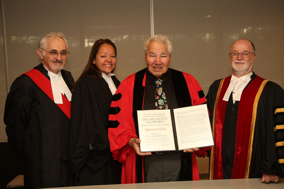 The Honourable Senator Murray Sinclair (centre) received an honorary LLD from the Law Society at its September 28 Call to the Bar ceremony in Toronto. He received the award in recognition of his distinguished legal career and his leadership, especially as Chair of Canada's Truth and Reconciliation Commission. From left to right: The Honourable George Czutrin, Senior Judge of the Family Court, Superior Court of Justice; Dianne Corbiere, Law Society Bencher; Law Society Treasurer Malcolm Mercer. (CNW Group/The Law Society of Ontario)