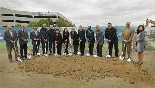 """Tryba Architects Principal Jeff Smith, Aimco Regional Vice President Brett Leonhardt, Aimco Executive Vice President of Operations Keith Kimmel, Fitzsimons Redevelopment Authority Consultant John Shaw, Aurora Community College Vice President George """"Skip"""" Noe, Aurora City Council Members Marsha Berzins and Nicole Johnston, Aimco Chairman and CEO Terry Considine, Aurora Mayor Bob LeGare, Aurora City Council Members Johnny Watson, Dave Gruber and Bob Roth, Aimco Chief Investment Officer John Bezzant and Aurora Economic Development Council President and CEO Wendy Mitchell break ground on 253 new Aimco apartments being developed near the Anschutz Medical and Fitzsimons Innovation campuses in Aurora, CO."""