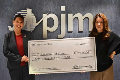 Nora Swimm, senior vice president – Corporate Client Services, PJM Interconnection, (right) presents a $20,000 donation to Natalie Reznik, regional philanthropy officer – American Red Cross Eastern Pennsylvania, (left) that will be used to support the American Red Cross' Hurricane Florence relief efforts.