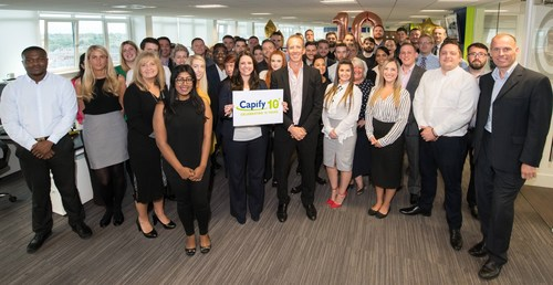 The UK Capify team join together to celebrate ten years in business (PRNewsfoto/Capify)