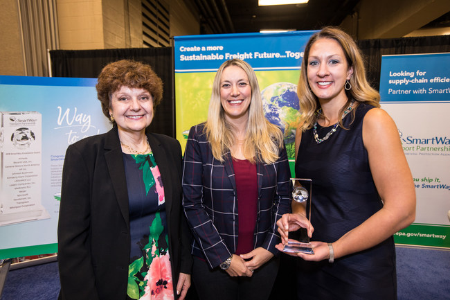 Amanda Tolhurst (center), Director, U.S. Logistics for Whirlpool Corporation, and Kara Hegg (right), Manager, Transportation for Whirlpool Corporation stand with Cheryl Bynum (left), National Program Manager, SmartWay, after receiving the EPA SmartWay Excellence Award.
