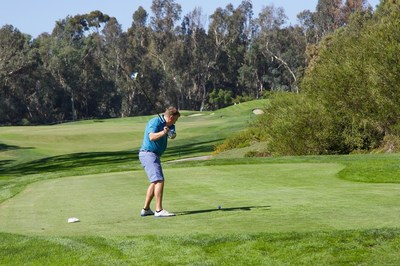 Wounded warriors are supported through a day of golfing.