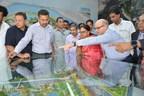 Mr Vinayak Deshpande, MD - TATA Projects explaining Dravyavati River Project to Ms Vasundhra Raje, CM-Rajasthan in the presence of Mr Vaibhav Galaria, JDC during the inauguration event. (PRNewsfoto/TATA Projects)
