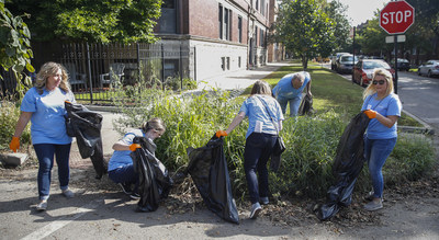 500 Gallagher employees mark 90,000 service-hours milestone by cleaning up streets in Chicago Cubs back yard.