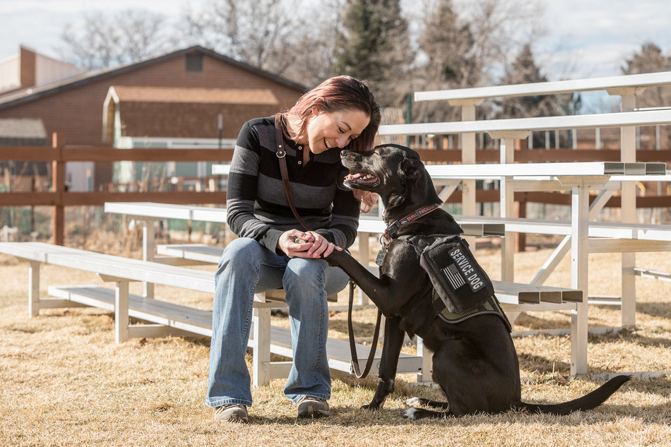 Handler Jennifer DiLuzio and service dog, Stryker. K9s for Warriors paired former shelter dog, Stryker, with Jennifer after she retired from active duty. Stryker helps Jennifer cope with symptoms of PTSD and gives her daily confidence and independence to enjoy her life.