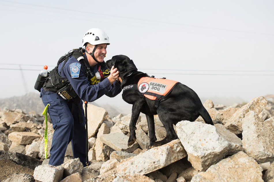 Handler Eric Lieuwen with search and rescue dog, Jake. After being found as a stray, Jake's high energy made him the perfect candidate for training with the National Disaster Search Dog Foundation. Jake and Eric were paired together for their first deployment in California after the Montecito mudslides in early 2018.