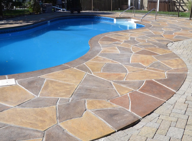 RenuKrete Concrete Pool Deck using Engineered Concrete Flooring system to get the look and feel of natural stone