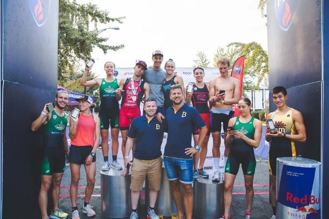 Top triathletes are paid their prize money in cryptocurrency at the podium in Charlotte, North Carolina