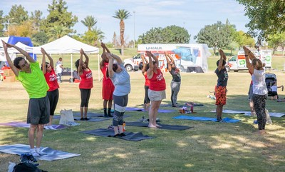 U-Haul Team Members, family and friends take yoga class in the park at the third annual U-Haul Active Day on Sept. 22 in Tempe. U-Haul was named to Comparably's 2018 list of top companies for work-life balance.