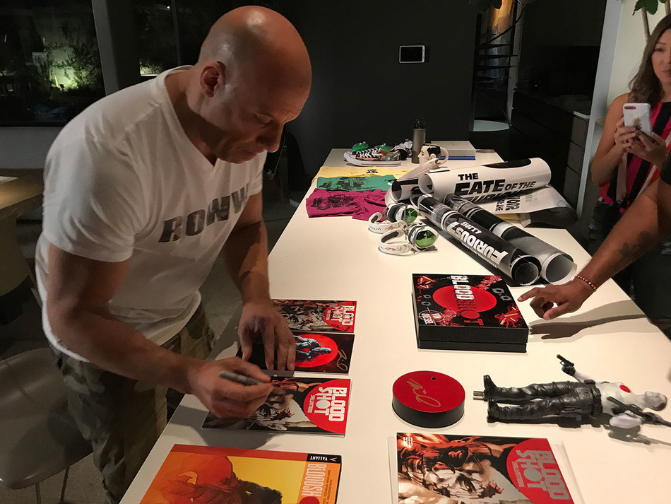 Bloodshot star Vin Diesel signs exclusive items for fourth annual Game4Paul fundraiser.