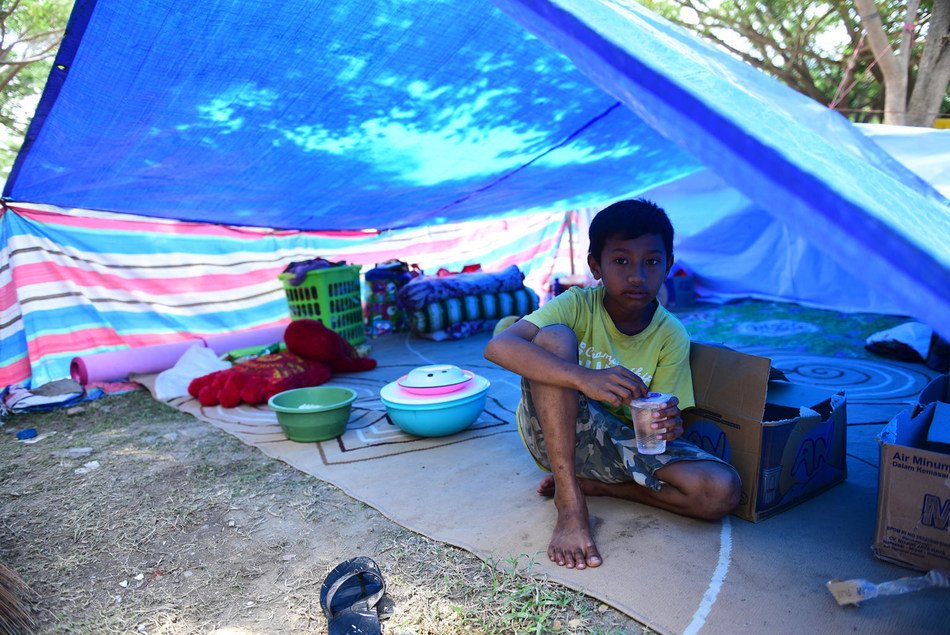 On 6 October 2018 in Indonesia, Haikal, 11 years old, in a tent for people displaced by the recent earthquake and resulting tsunami in Sis Al Jufri Airport area, Palu, Central Sulawesi. © UNICEF/UN0241655/Wilander (CNW Group/UNICEF Canada)
