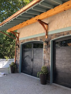 Installation of American Tradition Series carriage-style garage doors from Haas Door on the THIS OLD HOUSE(R)2018 IDEA HOUSE in Rhode Island. Photo courtesy of Sweenor Builders.